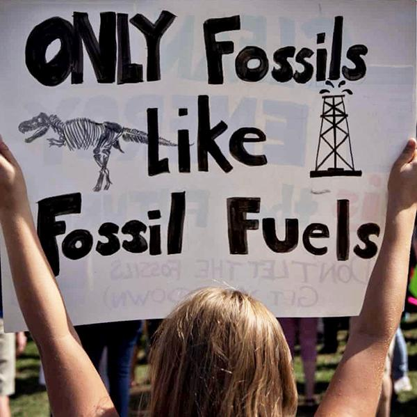 Sign displays the slogan: Only Fossils Like Fossil Fuels